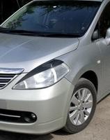 Накладки на фары (реснички) Nissan Tiida 2004-2007