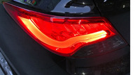 Стопы (фары) «BMW Design» для Hyundai Solaris 2010+ (дымчатые, красные)