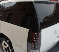 Задние альтернативные фонари стопы (оптика) «Eagle Eyes» на Cadillac Escalade