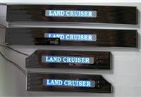 Накладки на пороги дверей с подсветкой Toyota Land Cruiser 200 (широкие)